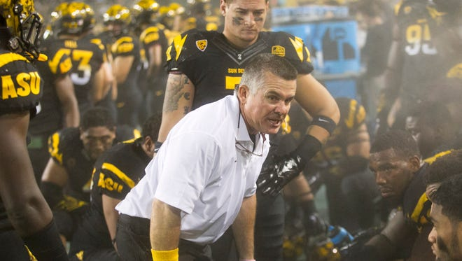 ASU head football coach Todd Graham shouts at his defense in the closing minutes of their 62-27 loss to UCLA at Sun Devil Stadium in Tempe on Thursday, Sept. 25, 2014.