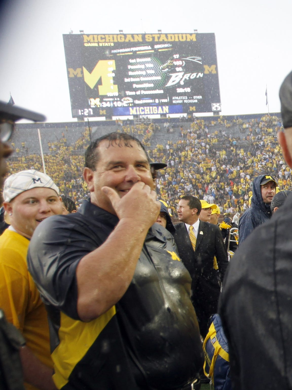 Brady Hoke shows mixed emotions as he leaves the field after his first game against Western Michigan in Ann Arbor on Sept. 3,  2011. The game was called early because of a storm as U-M won.