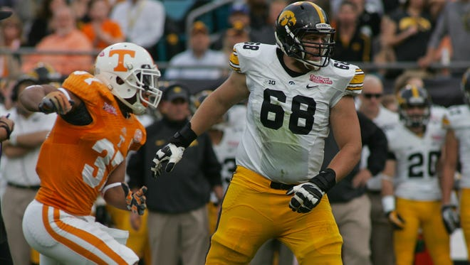 Iowa Hawkeyes offensive lineman Brandon Scherff (68) guards against Tennessee Volunteers defensive back Brian Randolph (37) in the first quarter of the 2015 TaxSlayer Bowl at EverBank Field. The Tennessee Volunteers beat the Iowa Hawkeyes 45-28.