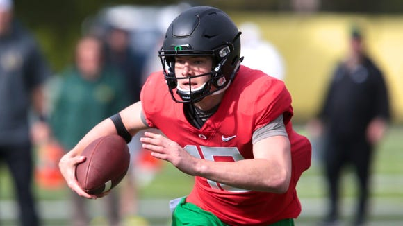 Apr 21, 2017; Eugene, OR, USA; Oregon Ducks quarterback Justin Herbert (10) runs the ball during spring practice at the Oregon Ducks outdoor practice facility. Mandatory Credit: Scott Olmos-USA TODAY Sports