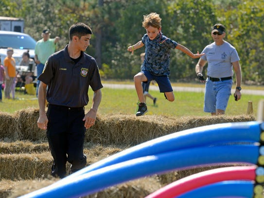 """""""Bad guy"""" James Kalber is chased by Brayden Ellis, 8, during a Cops & Kids Festival on Sept. 30. The Cops & Kids Spring Festival will be from 10 a.m. to 2 p.m. Saturday at Ashton Brosnaham Park."""