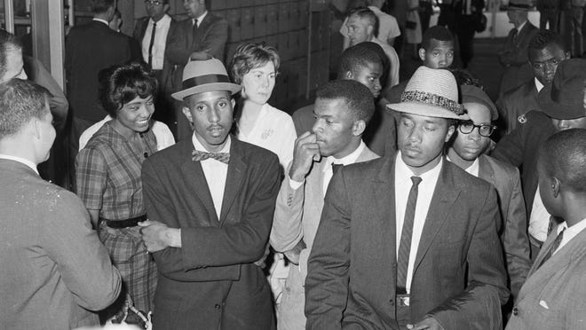 Bernard LaFayette, John Lewis, and other Freedom Riders at the Greyhound station in Birmingham, Alabama, 1961. N one of the drivers at the station would agree to take the Freedom Riders to their next destination.