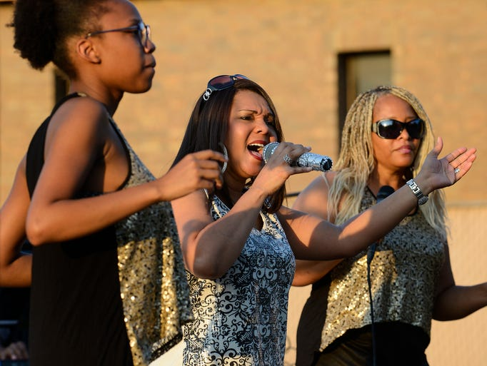 Lisa and The E-Lusion perform during the Back to School Street Dance on the Creek Walk in Prattville, Ala. on Friday August 15, 2014.