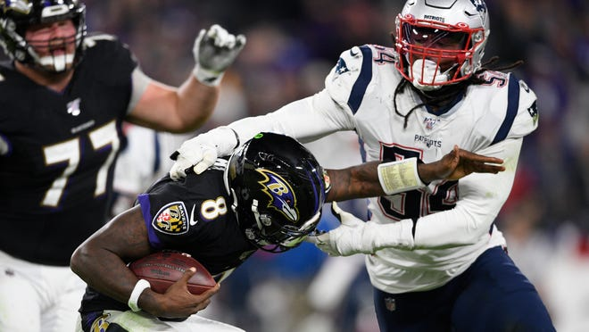 New England Patriots outside linebacker Dont'a Hightower (54) tackles Baltimore Ravens quarterback Lamar Jackson (8) last season in Baltimore. Hightower is among the 66 players who have opted out of the 2020 NFL season due to the coronavirus pandemic.