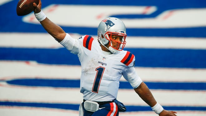 New England Patriots quarterback Cam Newton (1) reacts after rushing for a touchdown during the second half of an NFL football game against the Buffalo Bills Sunday, Nov. 1, 2020, in Orchard Park, N.Y.
