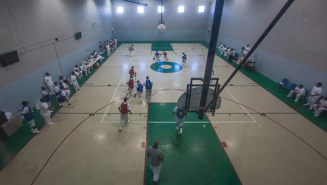 There are presently no inmates having to be housed in the gym at the Howard Young Prison and it allows them to hold basketball as the gym was intended thereby improving moral of inmates, guards and prison officials alike.