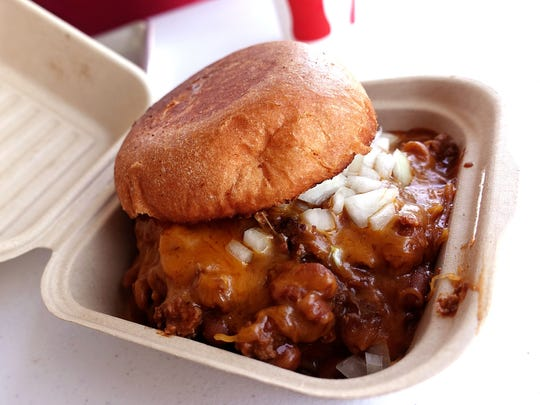 Chili burger with Laura's chili beans, cheddar cheese