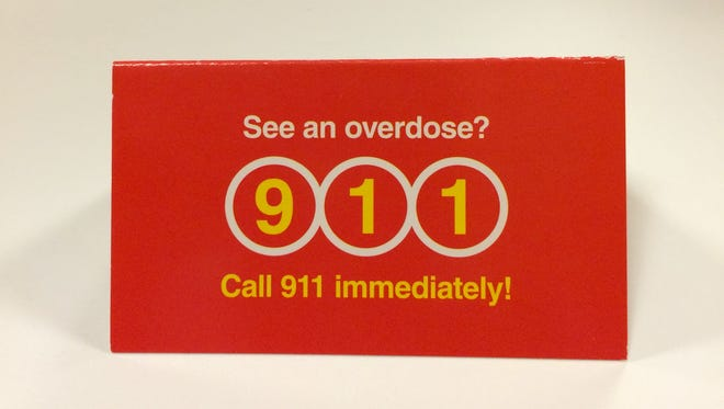 Patty DiRenzo will hand out these cards in Camden with information on what to do if someone overdoses on heroin or other opiates.
