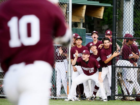 Teammates cheer on Morristown's Tate Ballestero's second