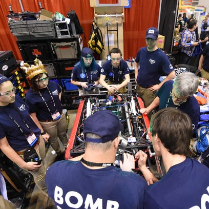 Bomb Squad robot operator Holly Simpson, left, and driver Sean Munson, right, concentrate as the maneuver the team's robot during competition Thursday at the Edward Jones Dome in St. Louis, Mo., during the 2016 FIRST World Championship.