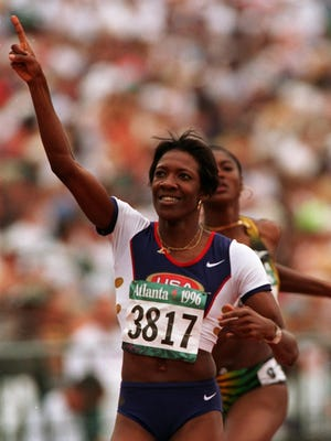 Kim Batten of the United States reacts after finishing her heat in the women's 400 meter hurdles at the 1996 Summer Olympics in Atlanta on July 28, 1996.
