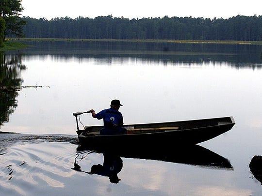 A fisherman heads out onto Lake Munson.