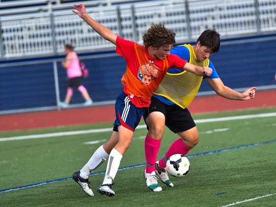 Connor Gniewek, left, and Myles Reed battle it out