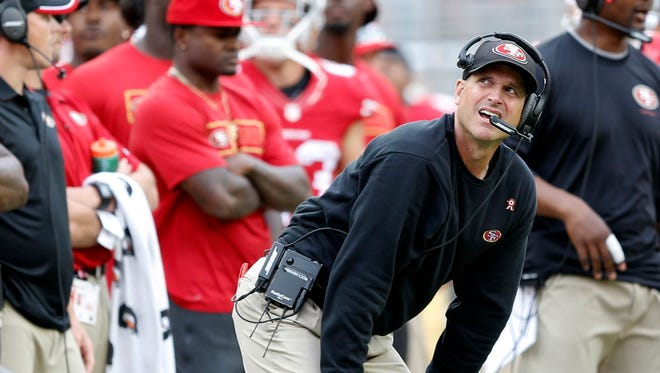 San Francisco 49ers head coach Jim Harbaugh watches the scoreboard from the sideline during the fourth quarter against the Philadelphia Eagles at Levi's Stadium. 49er's won 26-21.