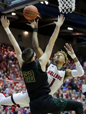 New Albany's Romeo Langford with an acrobatic shot against Floyd Central's Brendan Hobson in the Indiana 4A Sectional final. 