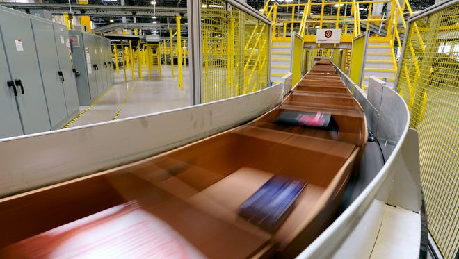 AMAZON Packages stream by at the Kenosha Amazon fulfillment center, which opened in June 2015.
