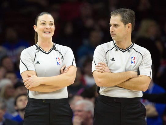 NBA referee Lauren Holtkamp (L) reacts with referee