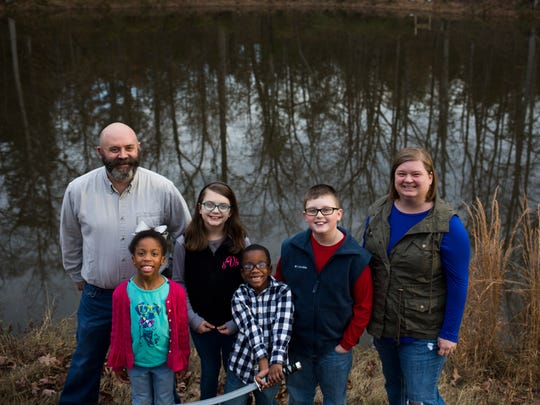 The Vernon family stands for a portrait Thursday at their home in Starr. Photographed from are dad Jamie Vernon, Delainey, 7, Emma Grace, 9, Taylor, 6, Solomon, 11, and lastly, mom  Hannah Vernon.