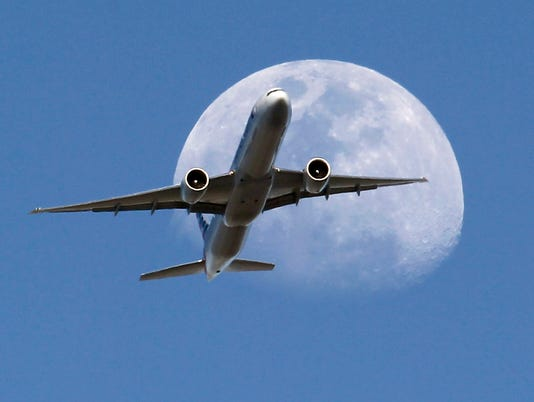 AP WAXING GIBBOUS MOON AIRPLANE A USA CA