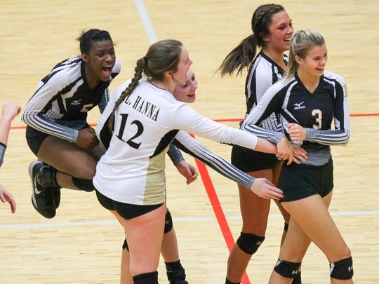 T.L. Hanna players celebrate a point made by T.L. Hanna's Mary Chamblee Craft, right, during the third set of the Class AAAAA state playoffs at Hillcrest High School in Simpsonville.