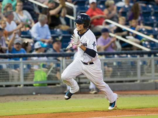 Luis Castillo (26) heads home to score on a double hit by Tyler Goeddel to take a 1-0 lead during the Mississippi Braves vs Blue Wahoos baseball game in Pensacola on Tuesday, June 13, 2017.