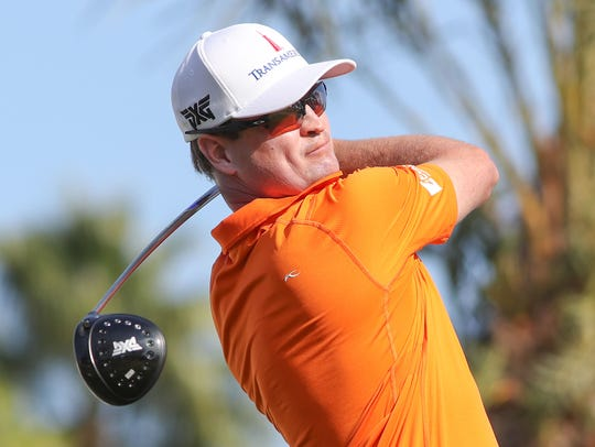 Zach Johnson tees off on the 9th hole of the Nicklaus