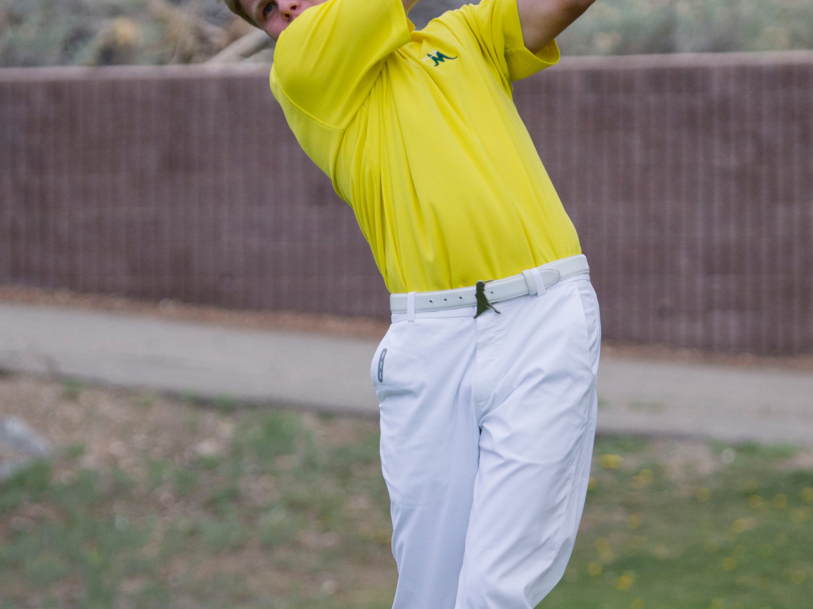 Bishop Manogue's Stephen Osborne tees off at Lakeridge Golf Course on April 11, 2014.