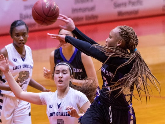 Mission Oak's Kambrayia Elzy shoots against Bakersfield