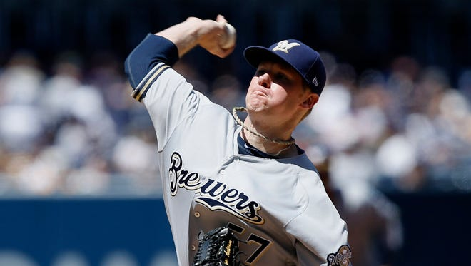 Brewers starting pitcher Chase Anderson was ill before facing the Padres on opening day in San Diego on Thursday.