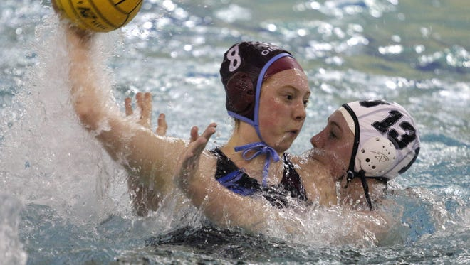 Sydney Fountain, left, and the Okemos girls water polo team is chasing its first state title since 2014.