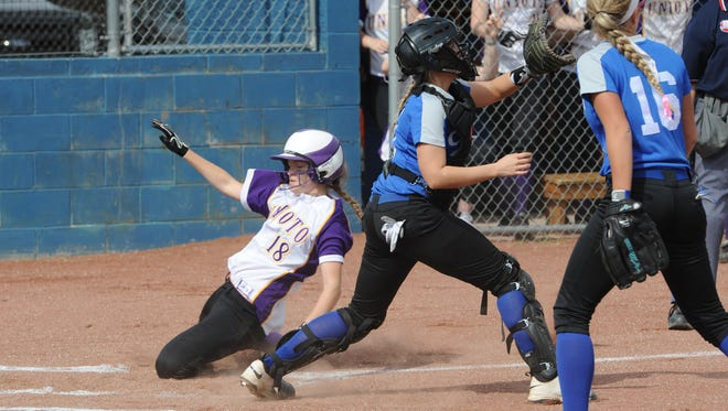 Unioto's Jayla Campbell slides safely into home plate as Chillicothe's McKenzie Allison awaits the throw. The Shermans beat the Cavaliers, 15-4.