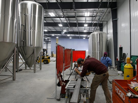 Fermentation tanks at the new Rivertown Brewery and Barrel House in Monroe.
