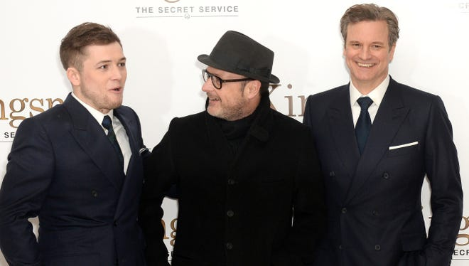 """Kingsman"" director Matthew Vaughn (with Taron Egerton, left, and Colin Firth) says he's a huge fan of spy flicks."