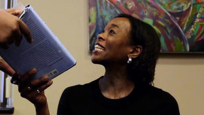 """""""Hidden Figures"""" author Margot Lee Shetterly signs copies of her book for Purdue University students and community members at the Black Cultural Center on Wednesday, Jan. 25, 2017. Shetterly held a Q&A session there before her public speech at Purdue Wednesday night."""