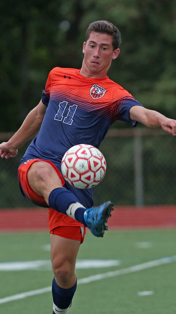 Greeley's Greg Ginsberg (11) moves the ball upfield against Somers during a boys soccer game against Somers at Somers High School Sept. 29, 2015. Greeley won the game 2-1.