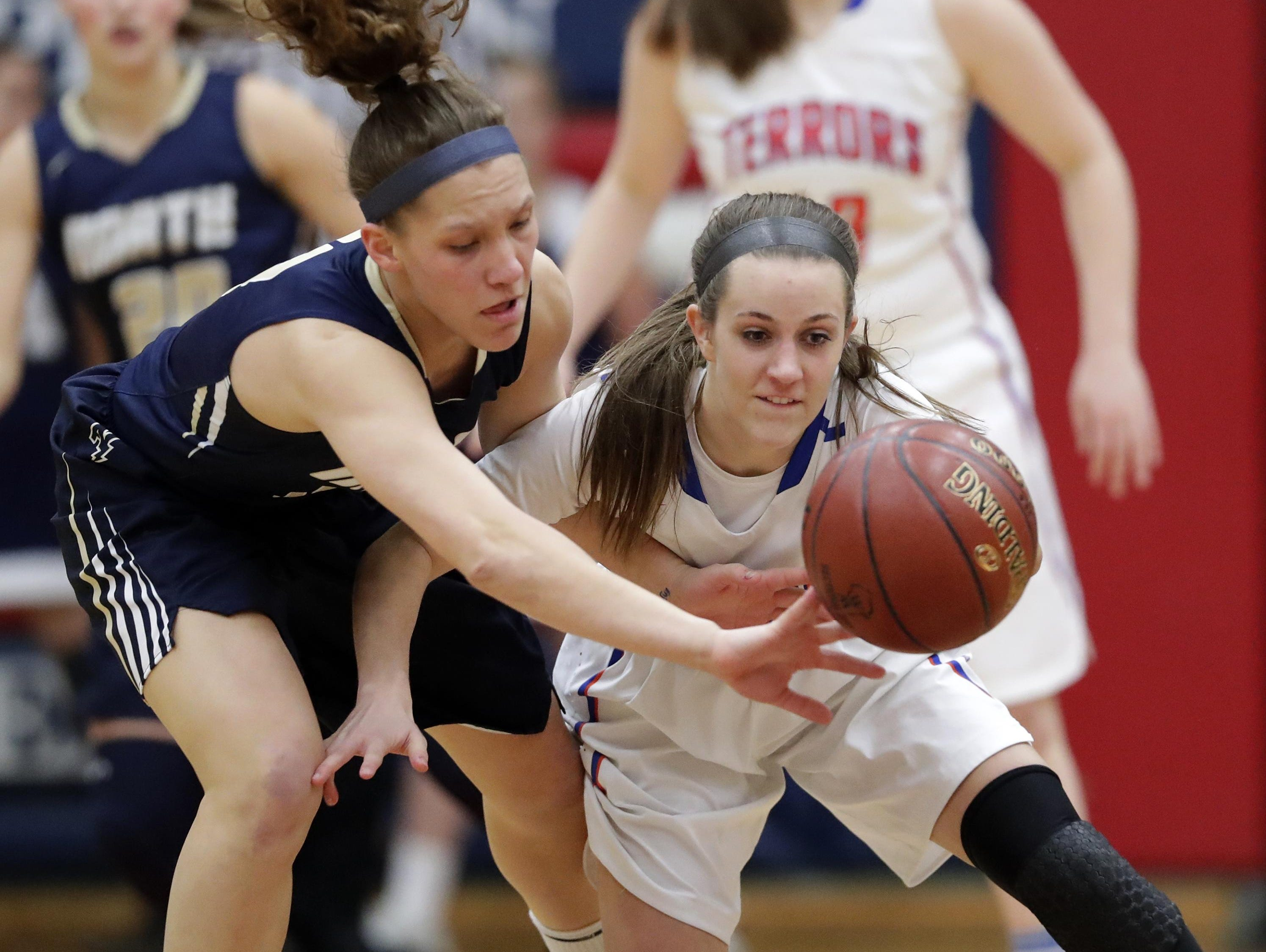 Appleton North's Callie Pohlman, left, defends a pass to Appleton West's Julia Smith on Thursday during a WIAA Division 1 sectional semifinal game at Appleton East.