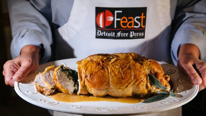 Detroit Free Press Food Writer Susan Selasky holds a rolled turkey breast with spinach stuffing she made while testing Thanksgiving recipes from readers for the MI Best Life recipe special section on Wednesday November 13, 2014.