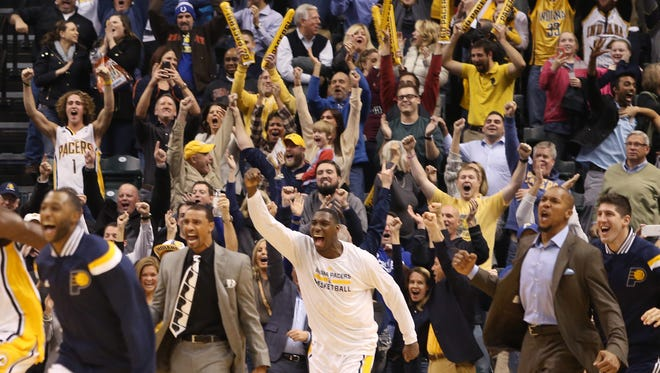 Indiana Pacers fans celebrate Solomon Hill's buzzer-beater lay-up that beat the Charlotte Hornets 88-86 at Bankers Life Fieldhouse, Nov. 19, 2014.