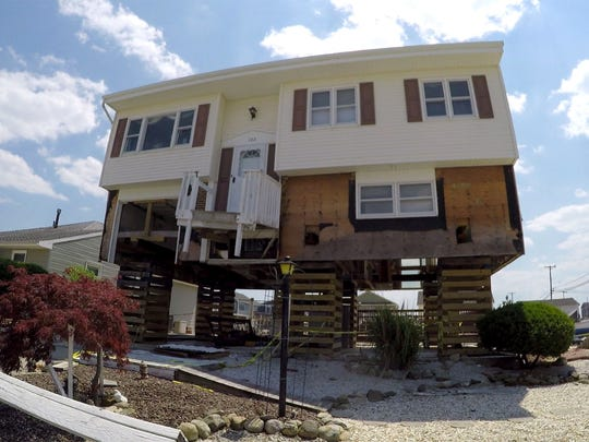 Little Egg Harbor resident Edwin Byk's lifted home on East Navesink Drive is shown Monday, June 12, 2016.  He decided to elevate his home after it was flooded with more than three feet of water during superstorm Sandy, but unfortunately his contractor, J&N, elevated the house (without permits) and then left, leaving Edwin in the lurch.