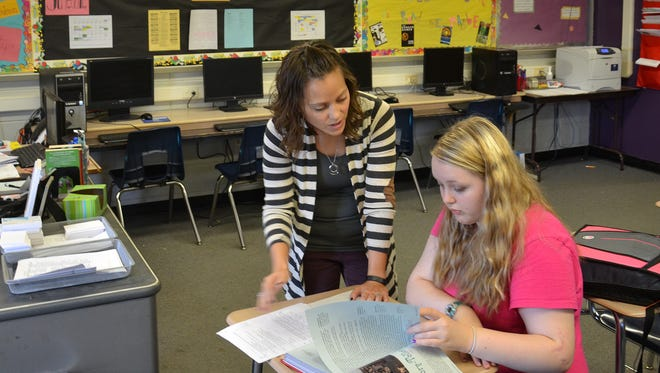 Lindsay Peterson teaches English-language arts to middle school and high school students in Centerville. Peterson said district officials are doing what they can to improve teacher salaries, but only with what state lawmakers give them.