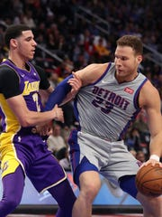 Pistons forward Blake Griffin drives around Lakers guard Lonzo Ball on March 26.