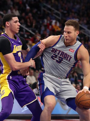 Pistons forward Blake Griffin drives around Lakers guard Lonzo Ball during the first half Monday, March 26, 2018 in Detroit.
