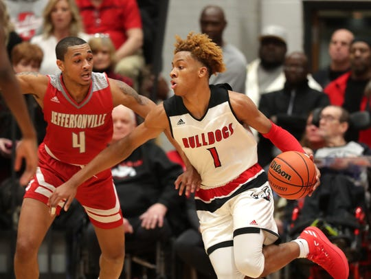 New Albany's Romeo Langford breaks for the basket against