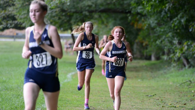 The Roberson girls will have a new cross country coach for next season.