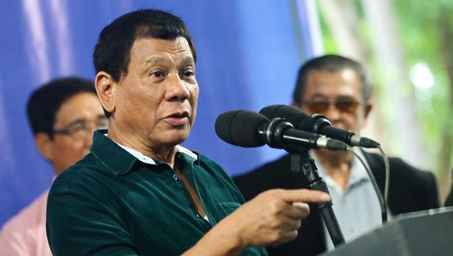 Filipino President Rodrigo Duterte speaks during a visit to troops in Iligan city in the southern Philippines on Friday.
