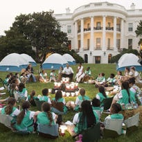 President Obama and first lady Michelle Obama talk with Girl Scouts.