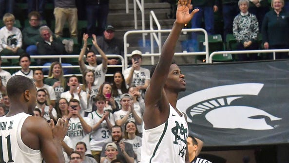 Senior Eron Harris, with his knee in a brace, waves