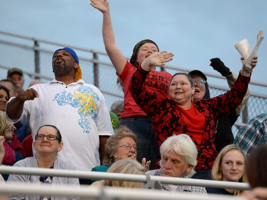 Family and friends cheer a Mountain Home High School graduate Friday evening at Bomber Stadium.