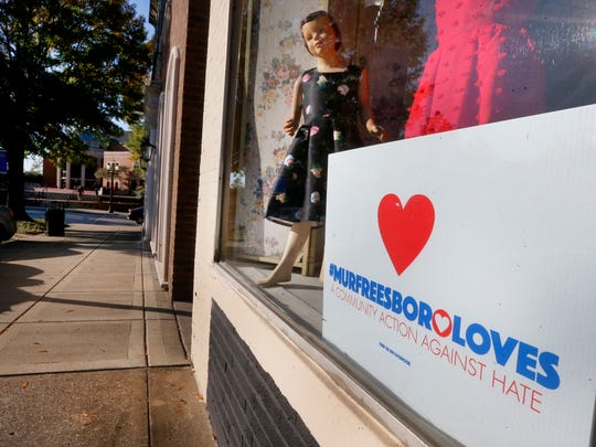 A MurfreesboroLoves sign is posted in the window of Sugaree's  off the square on Maple Street as the square prepares for the White Lives Matter rally and protesters on the square in Murfreesboro, on Friday, Oct. 27, 2017.