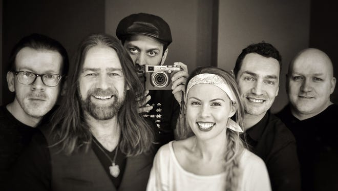 Alan Doyle, second from left, and his band The Beautiful Gypsies play Friday at the Fairport Music Festival.